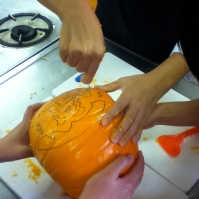 English Speaking Society students carving a pumpkin for the first time (October 2012)