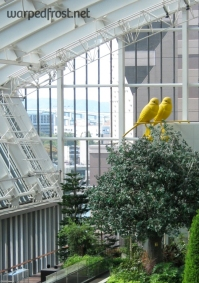 Two large canaries watch over patrons entering the Fukuoka Asian Art Museum (October 2009)