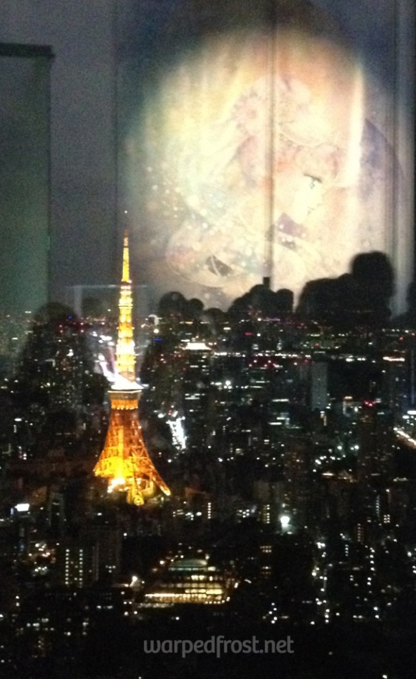 A large scroll of Neo Queen Serenity hanging inside the Sailor Moon Exhibit in Roppongi Hills reflected beautifully in the windows, making it look as if she were the moon over Tokyo. (April 2016)