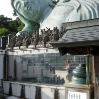 The coil in the foreground is the same size as the coils of hair on this Buddha's head (August 2010)