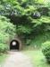 A tunnel on the grounds of Dazaifu Tenmangū Shrine. Beyond it is the mountain road up to Kamado Shrine. (April 2016)