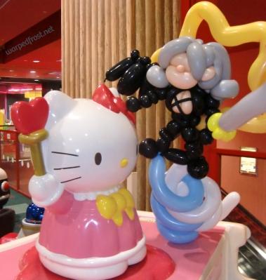 Balloon Seph next to a Hello Kitty figure
