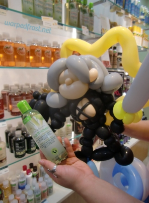 Balloon Seph looking at a body wash in The Body Shop