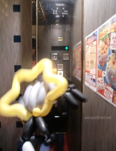 Balloon Seph pushes the button in the elevator for the right floor in the Karaoke kan. Or was it...