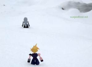 In a field of snow, Polygon Figure Cloud watches Polygon Sephiroth in the distance. Both figures are seen from the back.