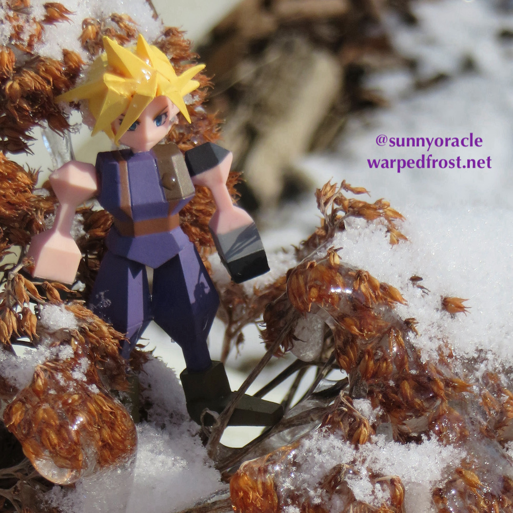 Cloud Strife Polygon Figure sitting in a dried sedum that is covered in snow and icicles